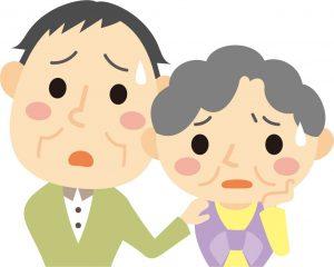 心配顔の老夫婦